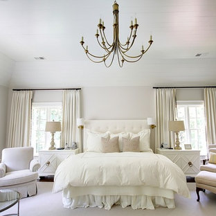 Elegant dark wood floor bedroom photo in Atlanta with beige walls