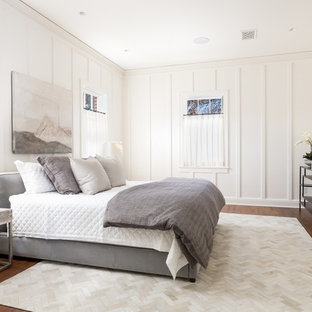 Bedroom - mid-sized transitional master medium tone wood floor and brown floor bedroom idea in Austin with white walls