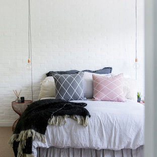 Medium sized scandinavian bedroom in London with white walls.