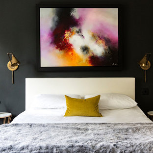 Inspiration for a contemporary master bedroom in London with black walls.