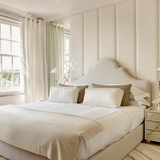 Photo of a classic master bedroom in London with beige walls.