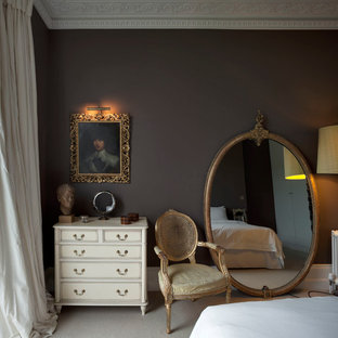 Bedroom - mid-sized eclectic master carpeted and gray floor bedroom idea in London with brown walls and no fireplace