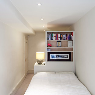 Example of a trendy carpeted bedroom design in London with white walls