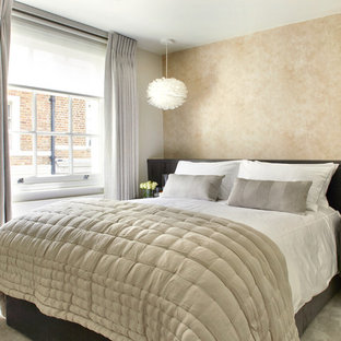 Design ideas for a traditional master bedroom in London with beige walls, carpet, beige floors and no fireplace.