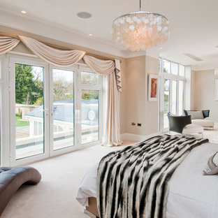 Inspiration for a timeless bedroom remodel in London with gray walls and no fireplace