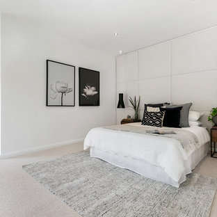 Photo of a contemporary bedroom in Hobart with white walls, carpet and grey floor.