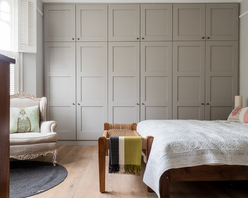 Inspiration For A Large Transitional Master Light Wood Floor Bedroom  Remodel In London With Gray Walls