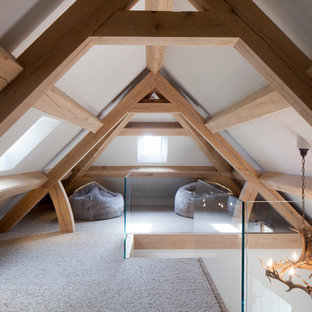 Design ideas for a large contemporary loft-style bedroom in Cheshire with white walls and carpet.