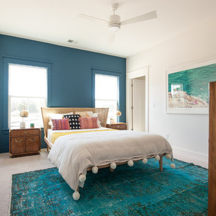 This is an example of a beach style bedroom in Charleston with blue walls, carpet and grey floor.
