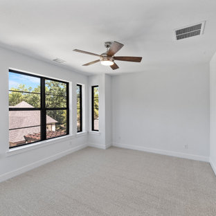 Example of a large trendy guest carpeted and gray floor bedroom design in Dallas with white walls