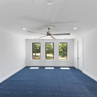 Example of a large trendy guest carpeted and blue floor bedroom design in Dallas with white walls