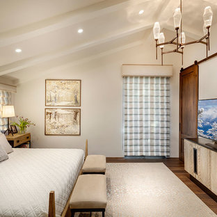 Inspiration for a mid-sized mediterranean guest bedroom in Other with yellow walls, medium hardwood floors and brown floor.