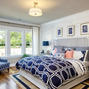 Example of a mid-sized transitional master medium tone wood floor bedroom design in Raleigh