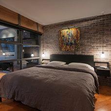 Contemporary Bedroom by Renocon Design
