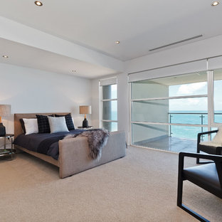 Design ideas for a contemporary master bedroom in Perth with grey walls and carpet.