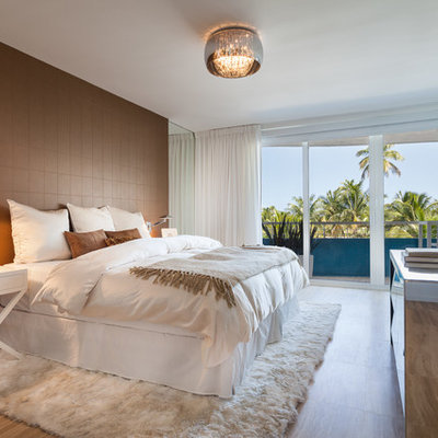 Mid-sized trendy master light wood floor bedroom photo in Miami with brown walls and no fireplace