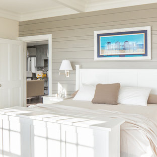 Bedroom - large beach style master dark wood floor bedroom idea in Portland Maine with beige walls