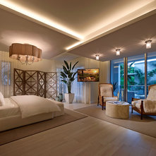 beach style bedroom by interiors by steven g beach style balcony helius lighting group