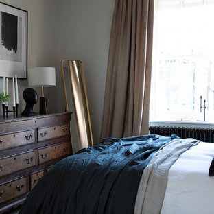 This is an example of a traditional bedroom in London with white walls.
