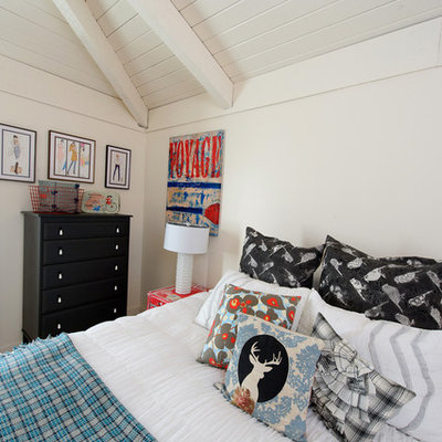 Inspiration for an eclectic bedroom remodel in Other with white walls