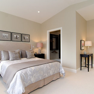 Design ideas for a contemporary bedroom in Vancouver with grey walls and carpet.