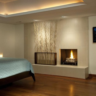 Bedroom - contemporary bedroom idea in Other with a tile fireplace and a standard fireplace