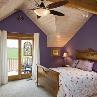 Photo of a traditional master bedroom in Other with purple walls and carpet.