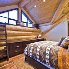 Rustic Bedroom by Sticks and Stones Design Group inc.
