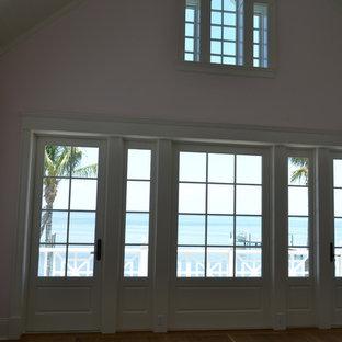 Bedroom - beach style master medium tone wood floor bedroom idea in Miami with pink walls