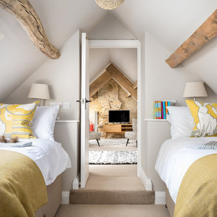 Inspiration for a small farmhouse guest bedroom in Gloucestershire with white walls, carpet and beige floors.
