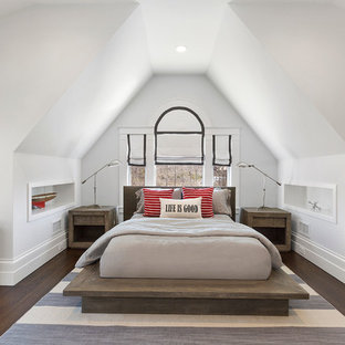 Design ideas for a mid-sized beach style guest bedroom in New York with white walls, medium hardwood floors and brown floor.
