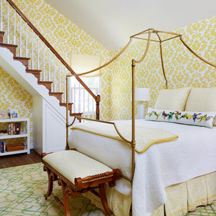 Example of a classic loft-style brown floor and medium tone wood floor bedroom design in DC Metro with yellow walls