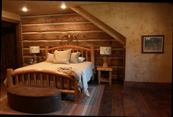 Traditional Bedroom by EverLog™ Systems: Worry Free Concrete Logs