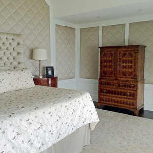 Example of a large eclectic master dark wood floor bedroom design in Baltimore with beige walls, a two-sided fireplace and a wood fireplace surround