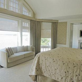 Foto de dormitorio principal, ecléctico, grande, con paredes beige, suelo de madera oscura, chimenea de doble cara y marco de chimenea de madera