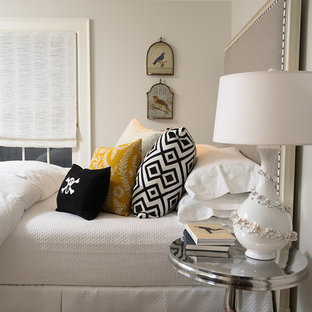 Example of a transitional bedroom design in New York with gray walls