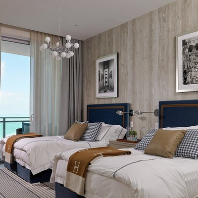 Large beach style guest carpeted and gray floor bedroom photo in Miami with brown walls and no fireplace