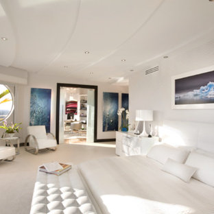 Mid-sized minimalist master limestone floor bedroom photo in Miami with gray walls and a standard fireplace