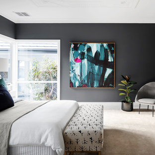 Contemporary bedroom in Melbourne with black walls, carpet and beige floor.