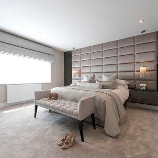 Classic bedroom in Hertfordshire with beige walls, carpet and beige floors.