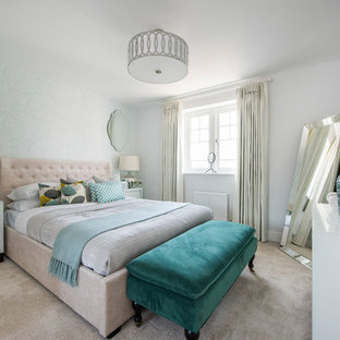 Medium sized traditional bedroom in Buckinghamshire with white walls, carpet and beige floors.