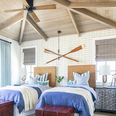 Bedroom - large tropical guest medium tone wood floor and brown floor bedroom idea in Orange County with beige walls
