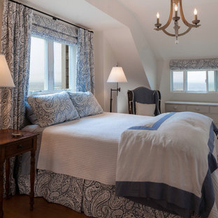Inspiration for a coastal medium tone wood floor bedroom remodel in Seattle with white walls