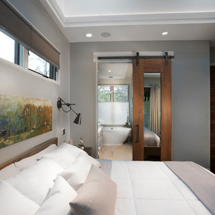 Inspiration for a mid-sized contemporary master dark wood floor and brown floor bedroom remodel in Other with gray walls and no fireplace