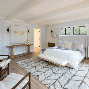 Large transitional master light wood floor and beige floor bedroom photo in San Francisco with gray walls
