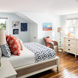 Bedroom - coastal dark wood floor and brown floor bedroom idea in Boston with blue walls