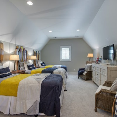 Example of a large beach style guest carpeted bedroom design in Minneapolis with gray walls