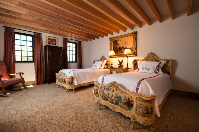 Traditional Bedroom by Island Architects
