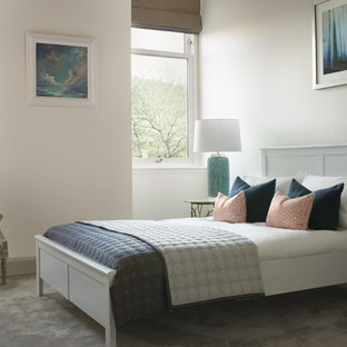 Medium sized contemporary guest bedroom in Edinburgh with white walls, carpet and grey floors.