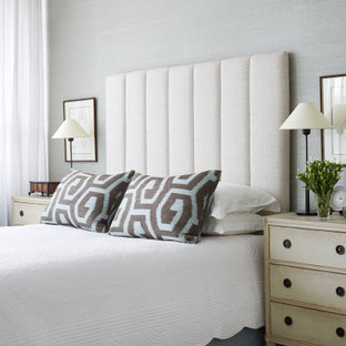 Design ideas for a large contemporary master bedroom in Melbourne with carpet, beige floor, grey walls and wallpaper.